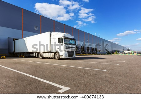 Cargo truck at warehouse building