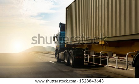 Cargo Truck on highway road with container, transportation concept.,import,export logistic industrial Transporting Land transport on the expressway againt sunrise sky #1528843643