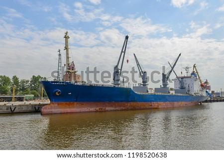Cargo vessel in port #1198520638