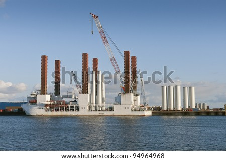 Cargo vessel loading windmill parts in the port at Esbjerg, Denmark
