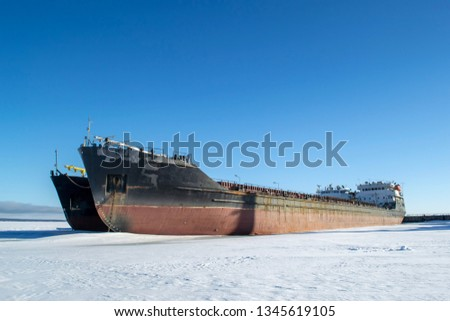 Cargo vessels at the port in the winter parking #1345619105