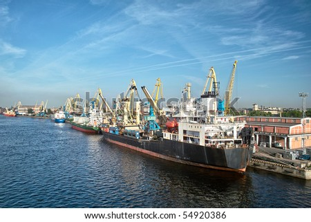 Cargoships and cranes in the harbor - stock photo