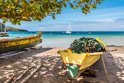 Caribbean bay on St. Lucia with boats on shore with fishing nets