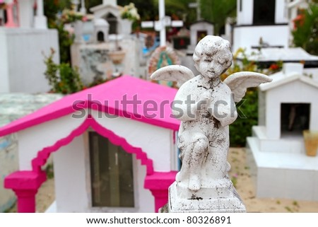 Caribbean children catholic cemetery with angel saints figures in Mexico
