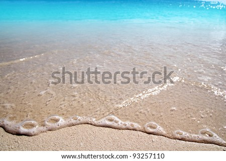 Caribbean clear beach sand texture shore wave foam - stock photo