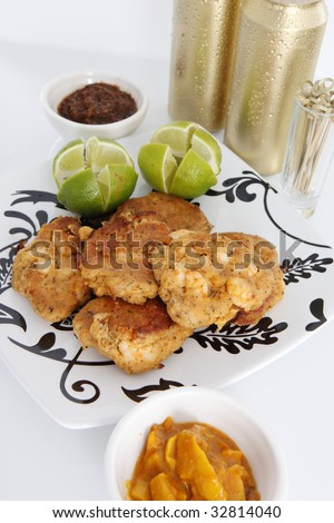 Caribbean conch, crab and shrimp patties, hot jerky sauce, mango chutney and cold beer