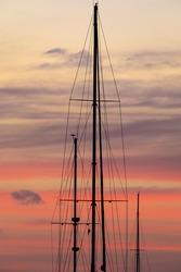 Caribbean, Grenada, Saint Vincent. Sailboat mast at sunset.