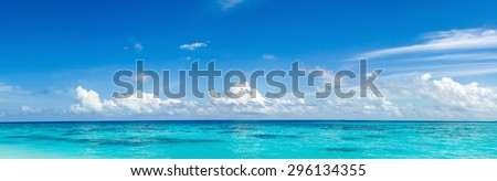 Caribbean panorama Hawaiian Maldivian Bahamian coast with a boat in a turquoise tropical sea