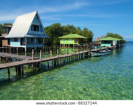Caribbean resort over the sea with wooden dock and bungalows on stilts, Crawl Cay, Bocas del Toro, Panama