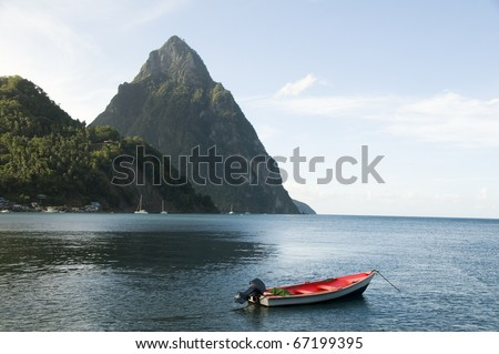 Caribbean Sea native fishing boat  with view twin piton peaks and volcano mountains  Soufriere St. Lucia island West Indies
