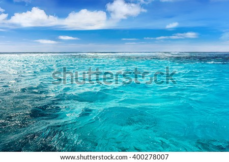 Caribbean sea surface summer wave background. Exotic water landscape with clouds on horizon. Natural tropical water paradise. Cuba nature relax. Travel tropical island resort. Ocean nature tranquility