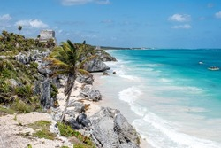 Caribbean sea view on the beach from above with the palm in Tulum, sandy beach and blue water