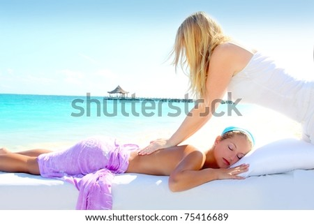 Caribbean turquoise beach chiropractic massage therapy woman