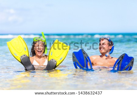 Caribbean vacation beach fun couple on summer holiday swimming with snorkel mask, ocean watersport activity. #1438632437