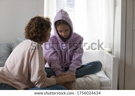 Caring Caucasian mother talk comfort unhappy sad teenage daughter suffering from school bullying or psychological problems, loving mom support make peace with depressed introvert teen girl child
