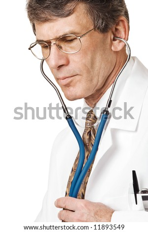 Caring Doctor listening through stethoscope. Closeup, isolated on white