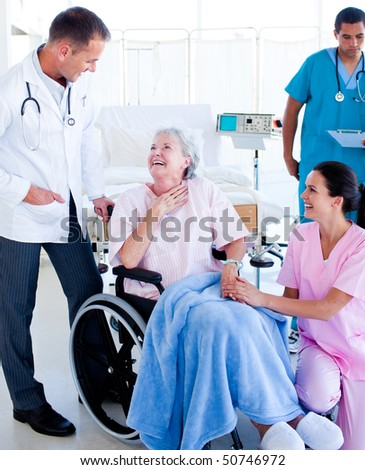 Caring medical team taking care of a senior woman at hospital