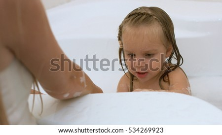 Free photos Mother and her kids taking a bath together | Avopix.com