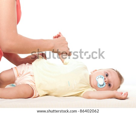 Caring mother's hands changing her little baby boy