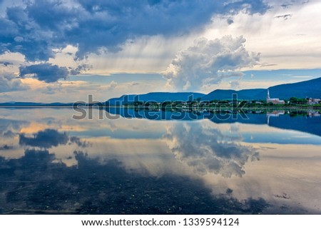CARLETON QC/CANADA JUNE 29 2018 A dramatic sky perfectly reflected in the lagoon at Carleton in Gaspesie, Quebec #1339594124