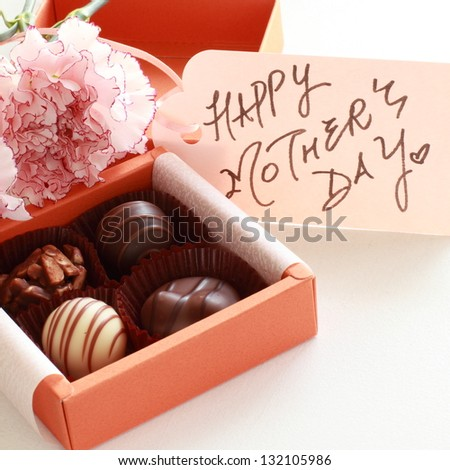 carnation and hand written mother's day card with chocolate for present
