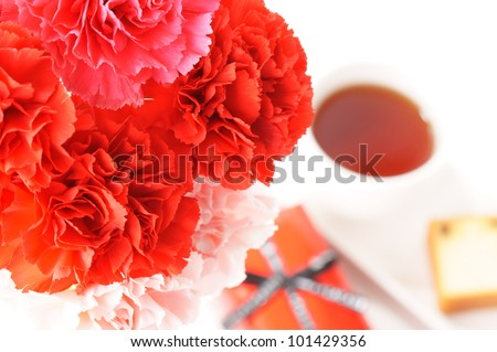 carnation bouquet with gift box,tea, and cake for Mother\'s day