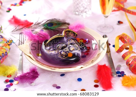 Carnival and party place setting with mask