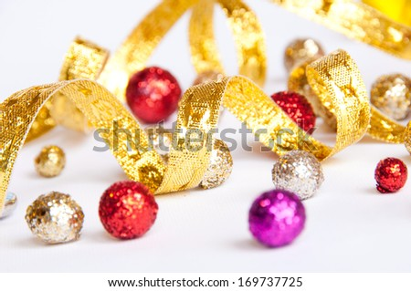 Carnival background with golden curling stream and glittering balls