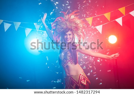 Carnival, belly dance and holiday concept - Beautiful female samba dancer wearing gold costume and smiling