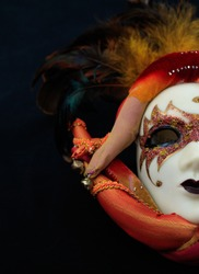 Carnival mask female theatrical half face against black background. Mardi gras party celebration, theatrical costume concept