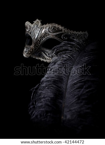 carnival mask isolated on black with feather