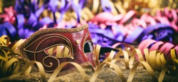 Carnival mask on colorful blur party background