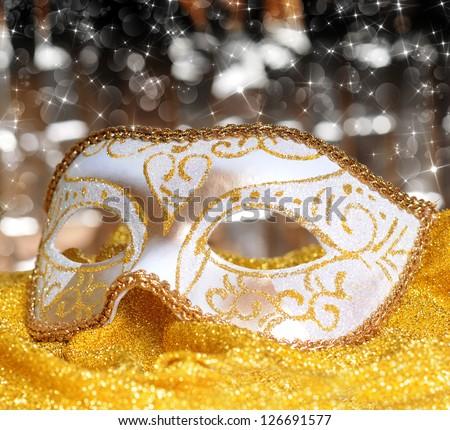 Carnival mask on golden material background