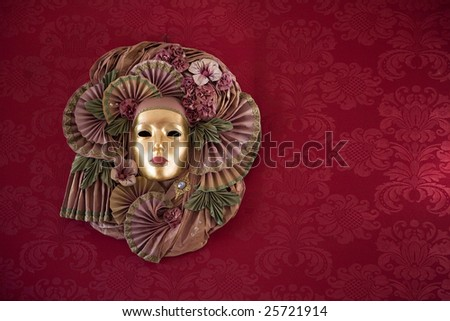 carnival mask over red background in venice - stock photo