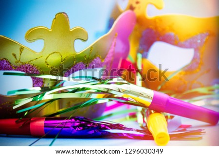 carnival masks and blowers with blue background