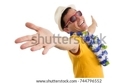 Carnival. Nice man is welcoming. Brazilian inviting for traditional holiday: Carnaval. He is wearing sunglasses and hat. Flower necklace. He is wearing a yellow jersey. Isolated on white background.
