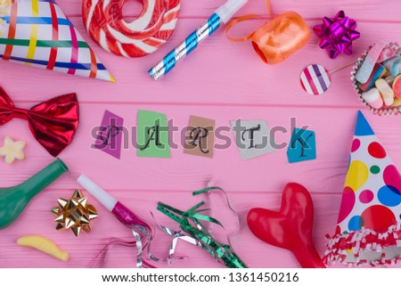 Carnival party background. Party background with letters, blowers, hats, balloons, sweets and other decorations.