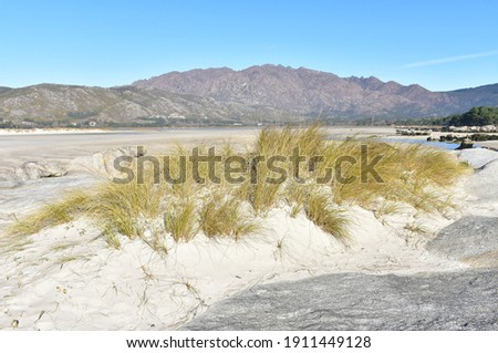 Carnota Beach or Playa de Carnota at Rias Baixas Region with Monte Pindo or Mount Pindo. Coruña, Galicia, Spain. Stok fotoğraf ©