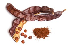 Carob beans with powder. Healthy organic sweet carob pods with seeds on white background. Top view
