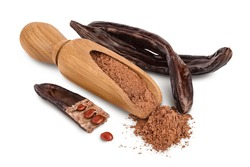 Carob pod and powder in wooden scoop isolated on white background with clipping path and full depth of field.