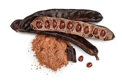 Carob pod and powder isolated on white background with clipping path and full depth of field. Top view. Flat lay