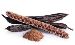 Carob pods, bean and carob powder isolated on white background.