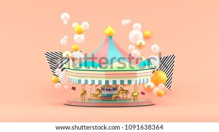 carousel among colorful balls...