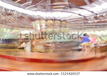Carousel in motion blur #1121420537