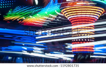 Carousel lights and movements, long exposure photography. Uk #1192801735