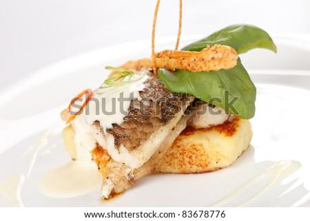 Carp fillet on roasted potatoes