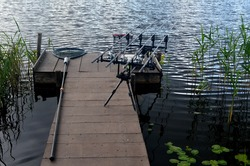Carp fishing rods in the lake. Rods on a rod pod with the swingers attached ready to catch a fish.