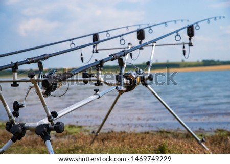 Carp fishing. Rods on a rod pod with the swingers attached ready to catch some fish. #1469749229