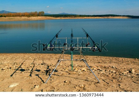 Carp fishing. Rods on a rod pod with the swingers attached ready to catch some fish monster. #1360973444