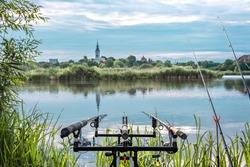 Carp fishing rods on rod pod isolated. fishing lake with rods isolated.